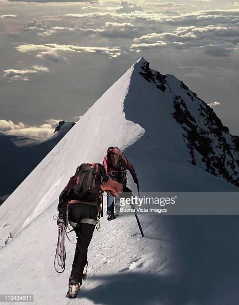 climbers ascending ta snowy peak - monte rosa foto e immagini stock