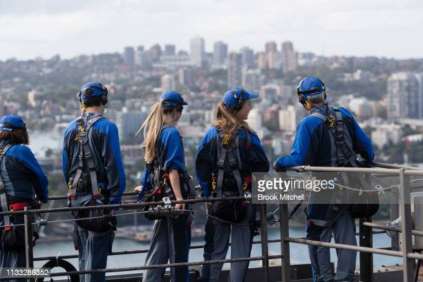 Climbers at the top of the Harbour Bridge take in the view on March 03 2019 in Sydney Australia The Clean Up Sydney Harbour event was founded by the...