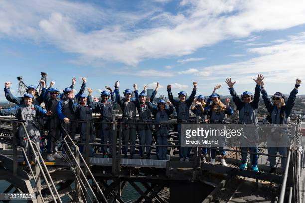 Climbers celebrate reaching the Harbour Bridge on March 03 2019 in Sydney Australia The Clean Up Sydney Harbour event was founded by the late Ian...