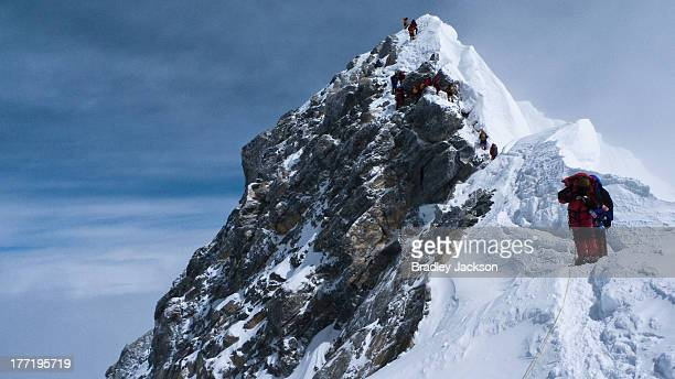Climbers descending the Hillary Step on Everest. Photo taken on the corniced ridge near the South Summit. Everest expedition 2010