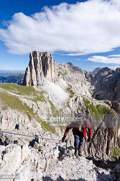 Climbers during the ascent to the Croda Rossa in the Rose Garden Group over the Croda Rossa via ferrata, below the Vaiolonpass, behind the Tscheiner peaks, Dolomites, Province of South Tyrol, Italy