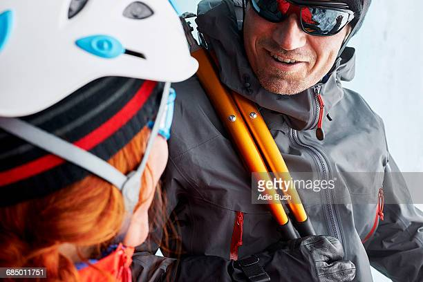 Climbers face to face smiling