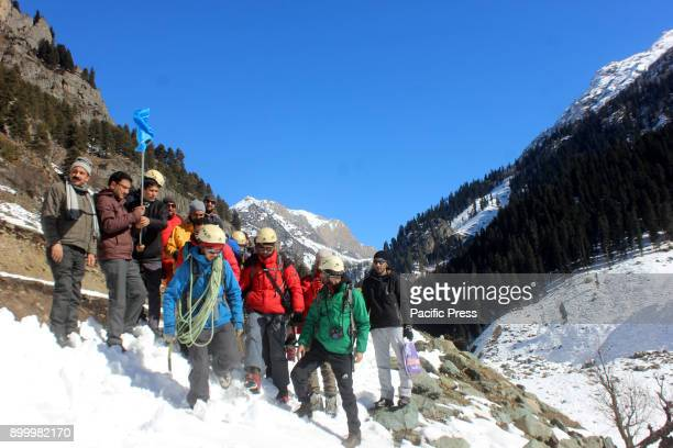 Climbers flag off by Government officials to trek for an hour during the extreme winter sports event to reach the destination at Chandanwari in...