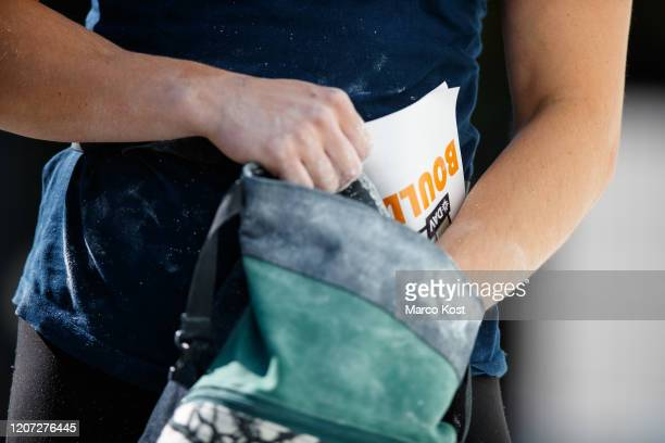 Climbers hands holding a chalk bag during the women's bouldering qualifications of the German Championship Olympic Combined climbing competition on...