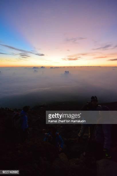 Climbers hiking mt Fuji during dawn