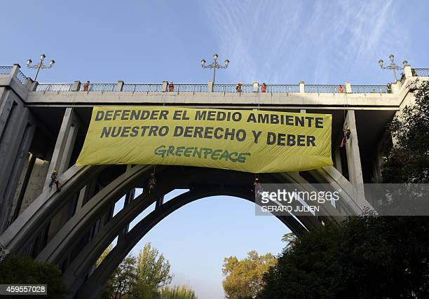 Climbers of the environmental group Greenpeace hang a banner on the Segovia Viaduct to demand the release of the Arctic Sunrise seized in Lanzarote...