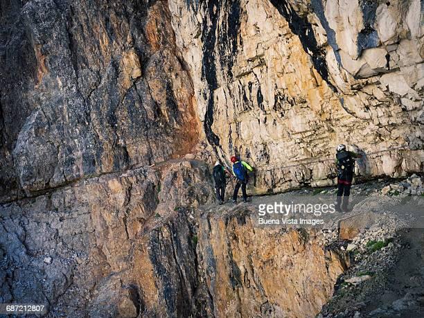 Climbers on a rocky wall