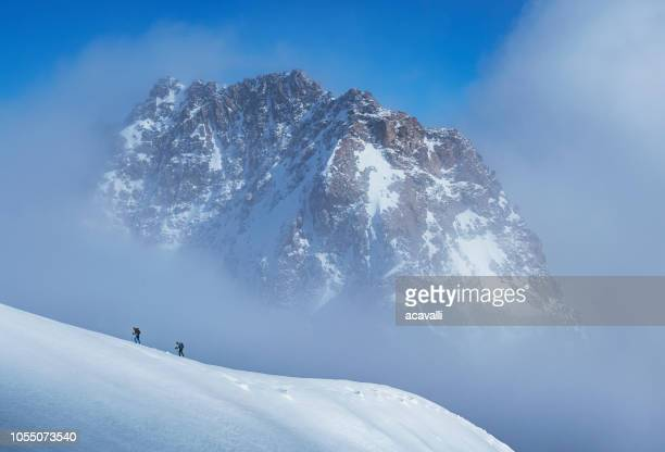 Climbers on a snowy slope.