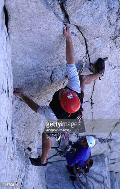 climbers on an ascent of eichorn pinnacle, cathedral peak. - pinnacle peak bildbanksfoton och bilder