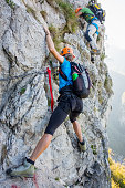 Climbers on equipped rockface
