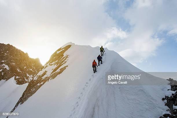 climbers on rochfort ridge ascending dent du geant, in mont blanc massif - クールマイヨール ストックフォトと画像