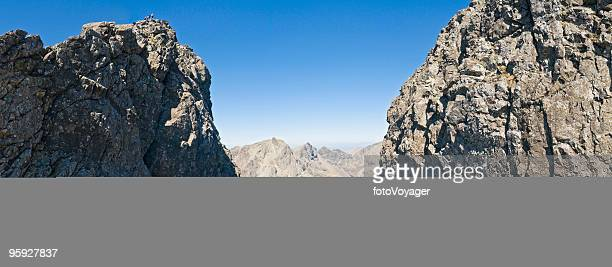 climbers on rocky summit scotland - ridge stock pictures, royalty-free photos & images