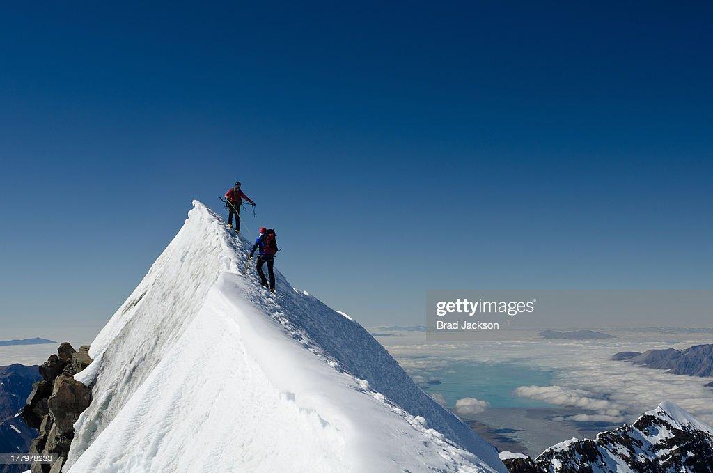 Climbers on summit ridge of Aoraki (Mt Cook) : Stock Photo