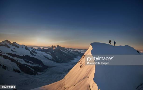 Climbers reaching the top of a mountain