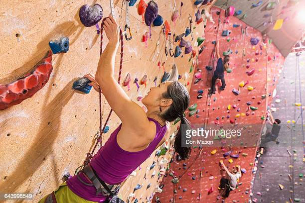 Climbers scaling rock wall