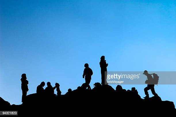 Climbers Silhouetted On Summit