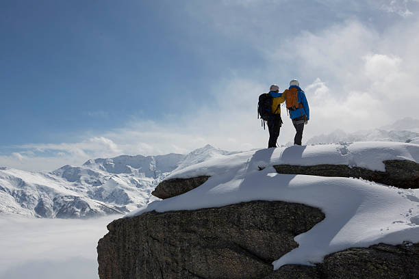 Climbers Stand On Snowy Mountain Summit, Look Off Wall Art