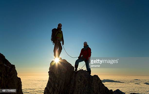 Climbers standing on rock