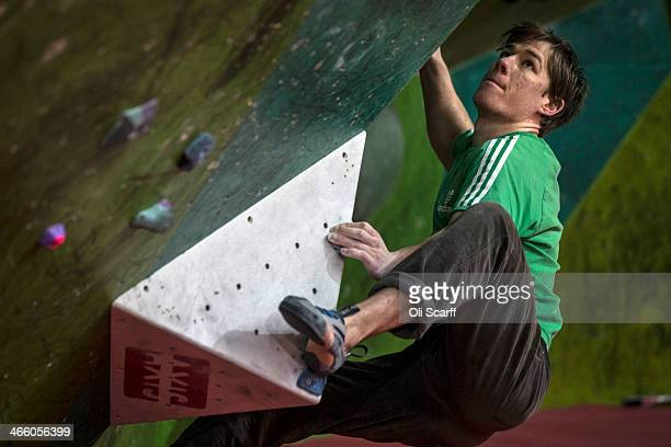 Climbers train at 'The Climbing Works' large indoor bouldering wall on January 30 2014 in Sheffield England Bouldering is climbing without the need...