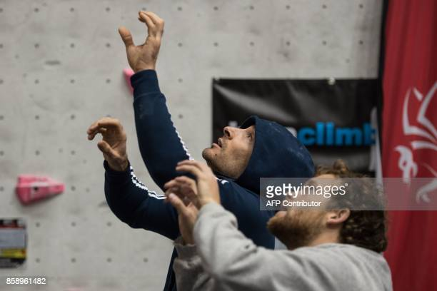 Climbers visualise their route up the climbing wall during their allotted 6 minute observation time before competing in the English stage of the IFSC...