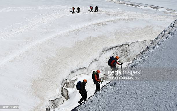 Climbers walk up the MontBlanc mountain on August 5 2015 near the Aiguille du Midi peak in Chamonix eastern France AFP PHOTO / PHILIPPE DESMAZES