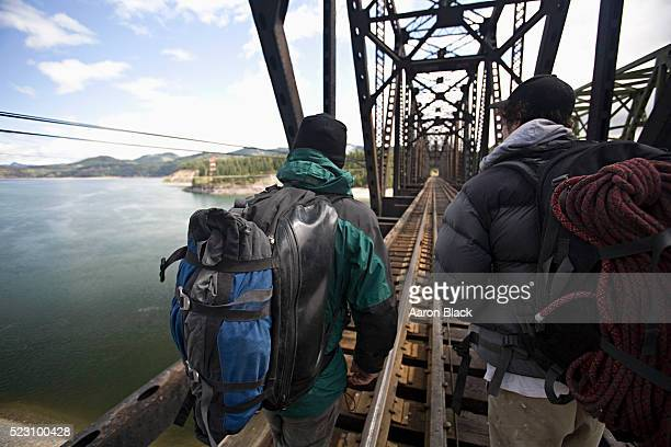 climbers walking across a trestle bridge - spokane stock pictures, royalty-free photos & images