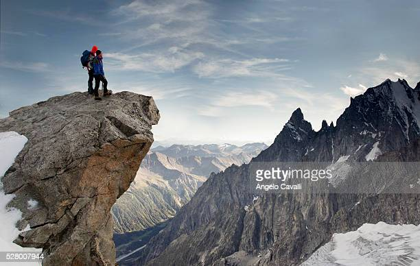 Climbers watching top of Mont Blanc from peak over Courmayeur