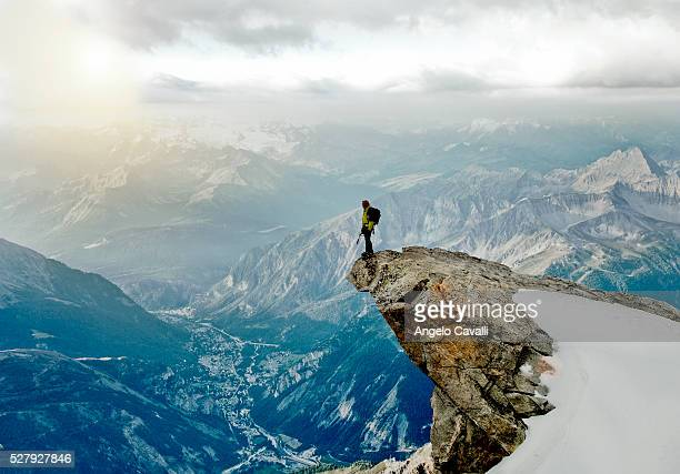 Climbers watching valley from peak over Courmayeur