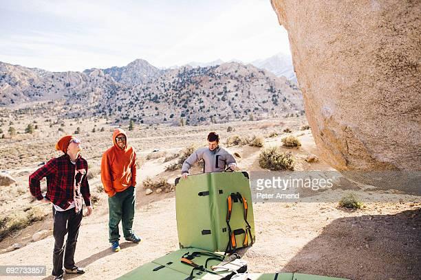 Climbers with bouldering mat, Buttermilk Boulders, Bishop, California, USA