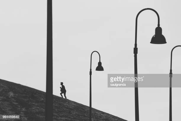 Climbing a hill with street lights in the foreground