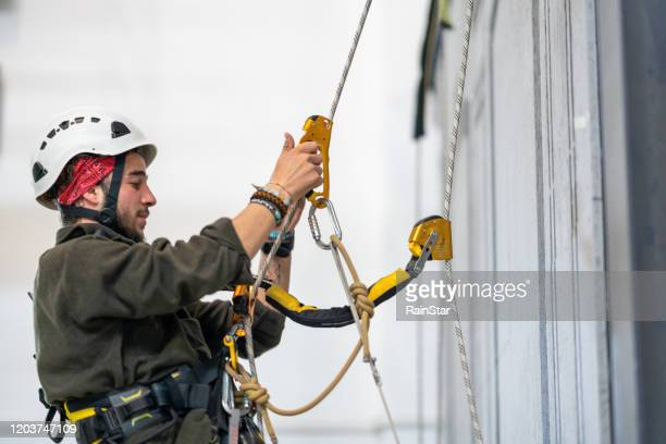 climbing climber - high up stock pictures, royalty-free photos & images