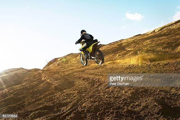 climbing hill on motocycle. - のりものに乗る ストックフォトと画像