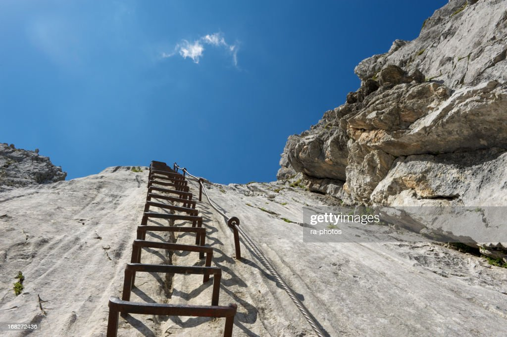 Climbing ladder in the mountains : Stock Photo