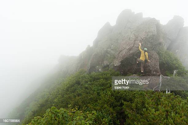 climbing mountain peak in mist, nagano, japan - ippei naoi stock photos and pictures