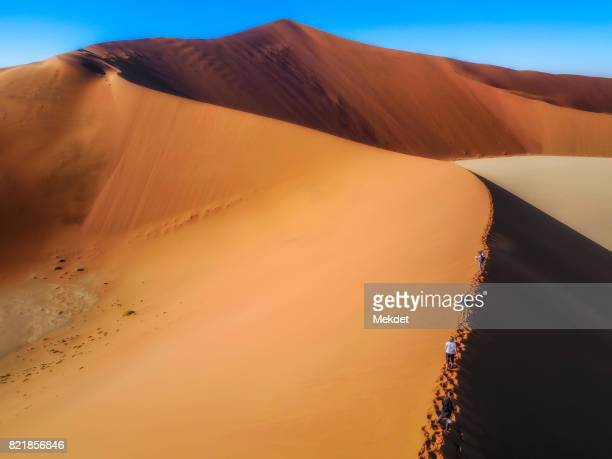 Climbing on Big Daddy Sand dunes, Sossusvlei, Namib-Naukluft National Park, Namibia
