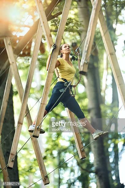 climbing on suspension bridge