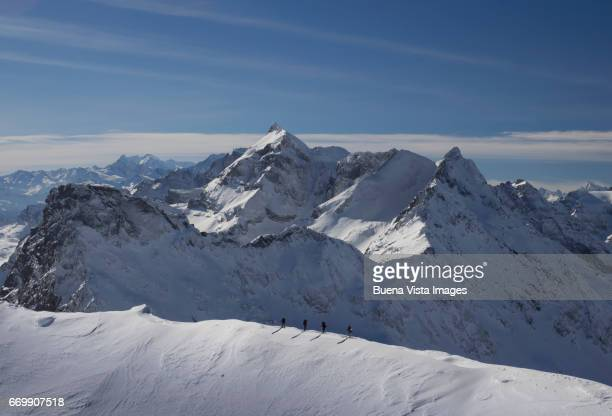 climbing team on a snowy crest - mountain ridge stock pictures, royalty-free photos & images