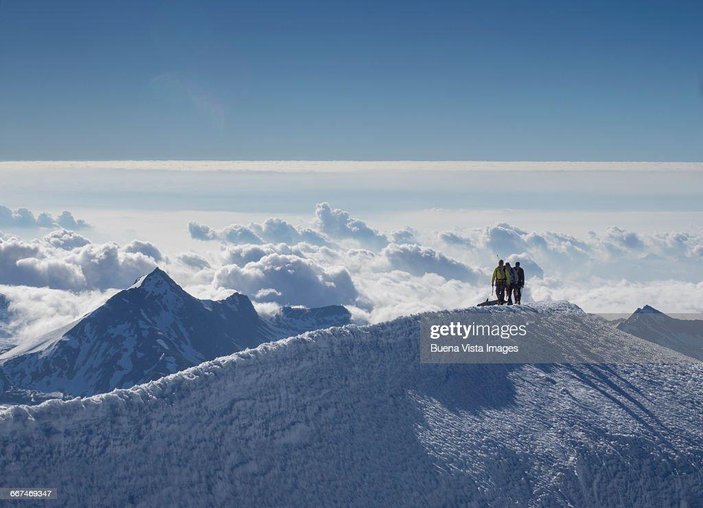 Climbing team on a snowy ridge : Stock Photo