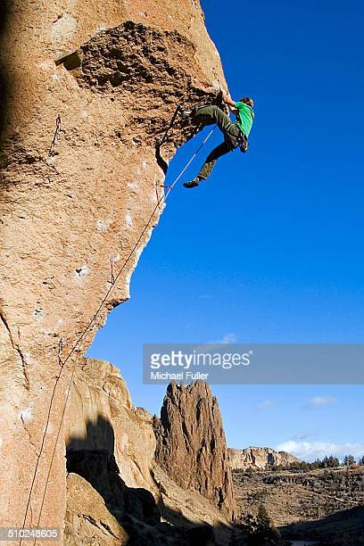 climbing the crux - smith rock state park stock pictures, royalty-free photos & images