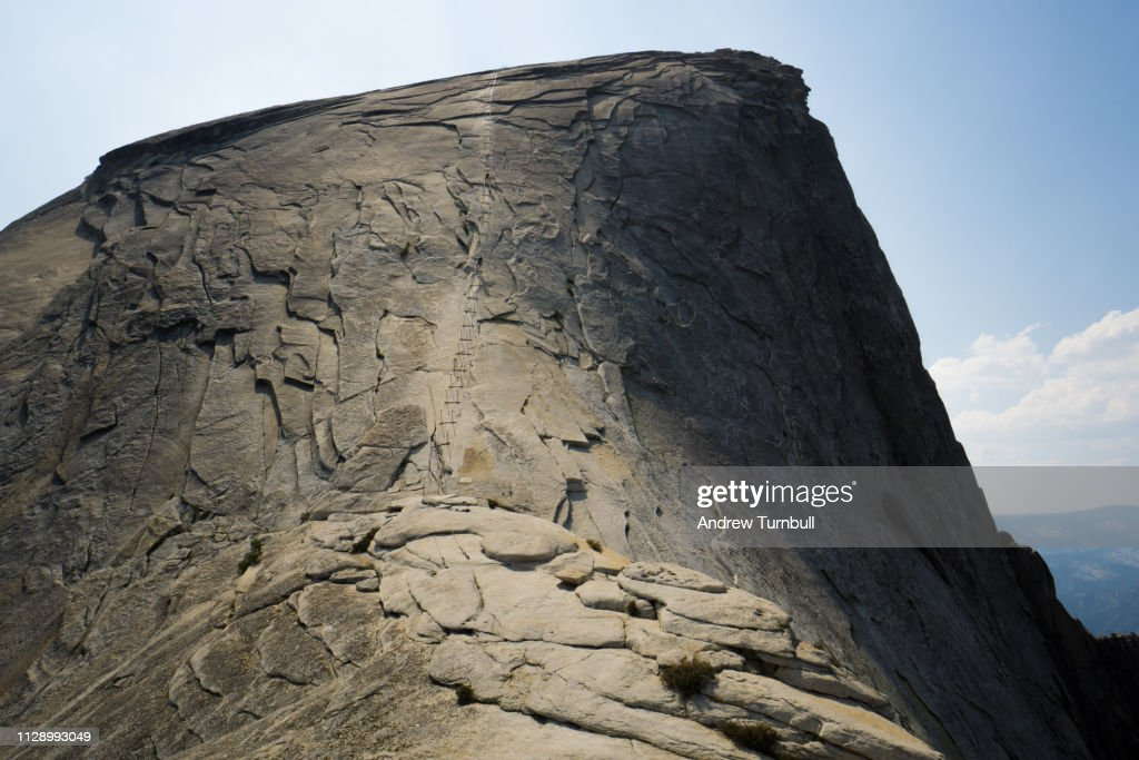 Climbing the Half Dome Cables, Yosemite National Park : Stock Photo