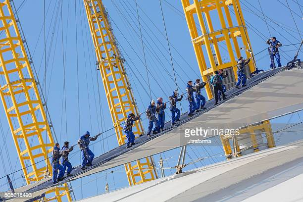 climbing the millennium dome - the o2 england stock pictures, royalty-free photos & images