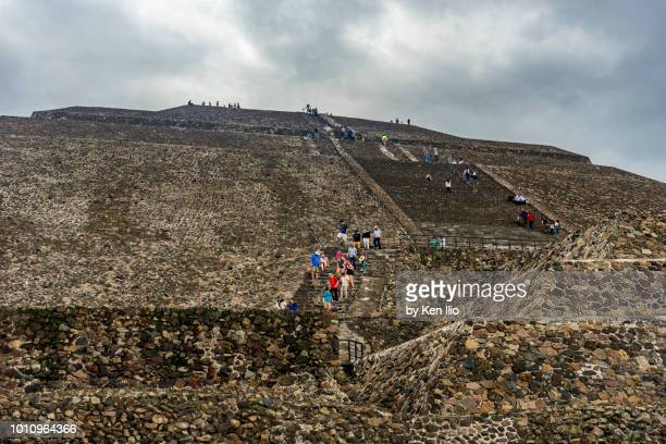 climbing the pyramid of the sun - ken ilio stock photos and pictures