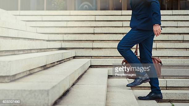 climbing the steps to success - steps stock photos and pictures
