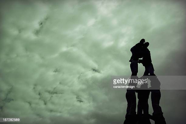 climbing to the clouds - castellers stock photos and pictures