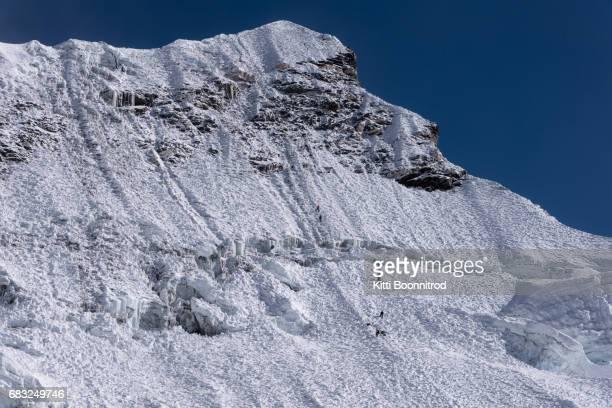 Climbing to the summit of Island peak in Nepal