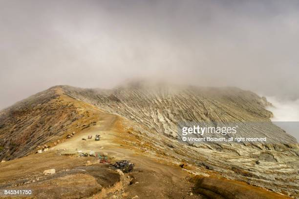 climbing up kawah ijen volcano in java, indonesia - sulfuric acid stock photos and pictures