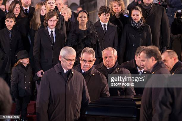 Céline Dion and her sons René-Charle Eddy and Nelson follow the casket of her late husband René Angélil following his funeral service at Montréal's...