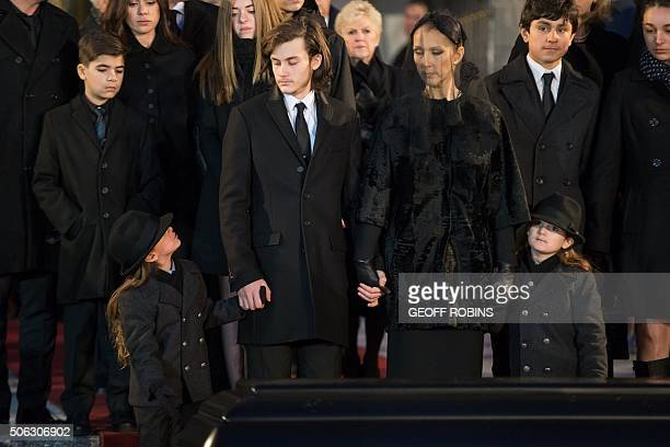 Céline Dion and her sons René-Charle Eddy and Nelson wait as the casket of her late husband René Angélil is prepared to be carried into a hearse...