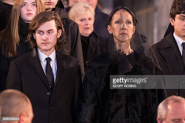 Céline Dion and her sons René-Charle wait as the casket of her late husband René Angélil is carried to an awaiting hearse following his funeral...