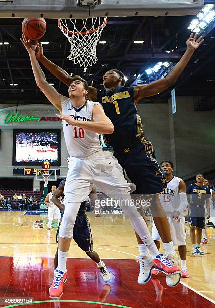 J Cline of the Richmond Spiders drives to the basket against Ivan Rabb of the California Golden Bears during the 2015 Continental Tire Las Vegas...